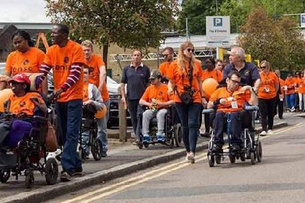 Staff and people with complex disabilities from Sense participating in a Sense Walk