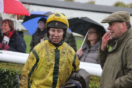 Richard Johnson wears the Rasen mud as he talks to trainer Harry Daly after his Bud Booth Mare's Chase win. Picture: Peter Thompson EMN-191111-084955002
