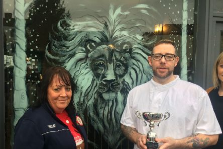 Rachael Bell presented the trophy to March Hare owner Trevor Guerin
