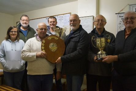 Club members pictured with their trio of trophies at the end of last season EMN-200113-141649001