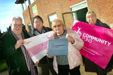 Andrew Lake and Colin Laws with Pam Posnett and Sarah Cox from Melton Learning Hub celebrating the new funding for full-time engagement officers to be based at The Venue. EMN-191202-173009001