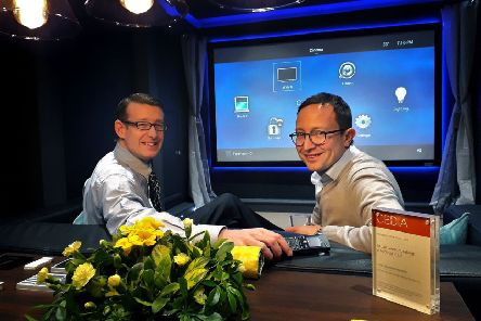 Director Richard Westmoreland and guest Charlie Reading sample the home cinema experience centre.