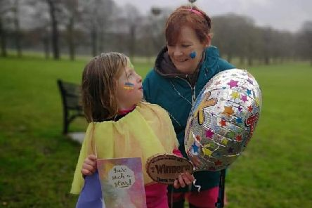 Evie Scarborough pictured with family friend, Heather, on the day she raised more than �1,000 for cancer treatment for her EMN-190703-105314001