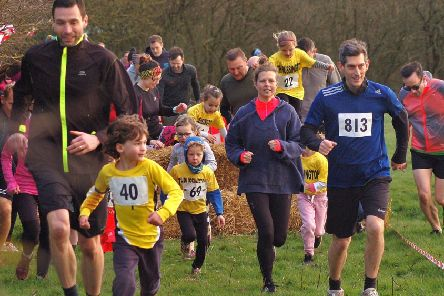 Parents lend a helping hand as the youngest fun runners tackle the Frisby course EMN-190313-093505002