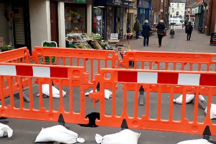 The scene in King Street, Melton, with a large sink hole fenced off by the county council EMN-190318-102435001