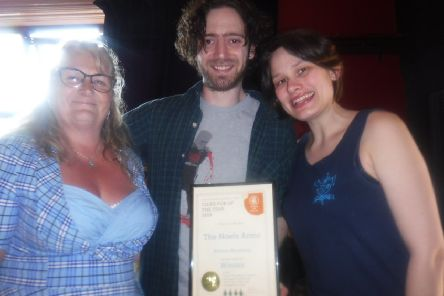 David Lawrence and Jessica Cresswell, landlords of the Noels Arms pub in Melton, are presented with a certificate, for their pub being named Melton CAMRA Cider Pub of the Year, by Karen Hine (left), a Melton branch of the Campaign for Real Ale Cider representative EMN-190531-105326001