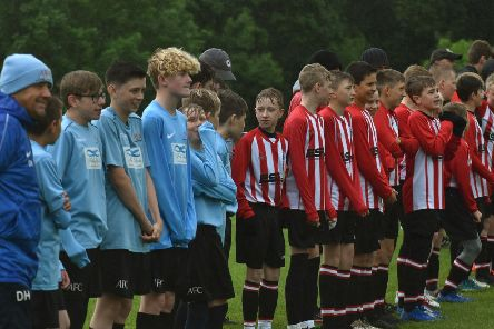 Asfordby FC and Mowbray Rangers line up for the national anthems EMN-191206-104527002