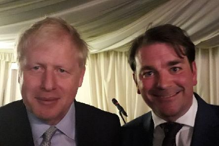 Boris Johnson with borough councillor Leigh Higgins at  a fundraising dinner at Melton Livestock Market EMN-190614-090739001
