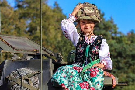 A child from Melton's Polish School climbs aboard a military vehicle after a special service at Saltby Airfield to honour paratroopers from Poland who flew from there to fight in the Second World War EMN-190310-112656001