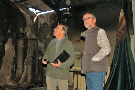 Chairman Brian Keevil and treasurer Ian Smith inspect the fire damage at Hose village hall a year ago EMN-190910-162042001