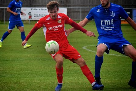 Town's leading scorer Zak Munton had a shot cleared off the line and hit the post at Irchester