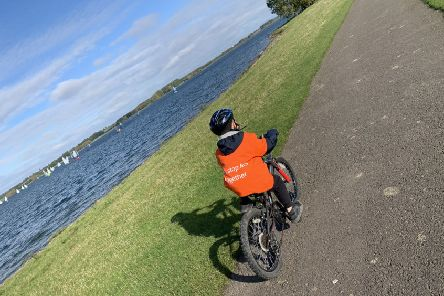 CJ Wood (7) conquers his fear of bike riding by pedalling around Rutland Water to raise money for MS sufferers like his dad EMN-190611-120345001