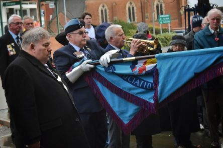 Deputy Mayor of Melton, Peter Faulkner, and Melton RAFA standard bearer Phil Taylor stand in silence as Phil Hardy sounds the last post at the Armistice Day service in Melton outside the Royal British Legion EMN-191111-125158001