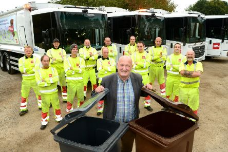 Melton Council leader, Councillor Joe Orson, with the authority's refuse lorries and collection team EMN-191212-154837001