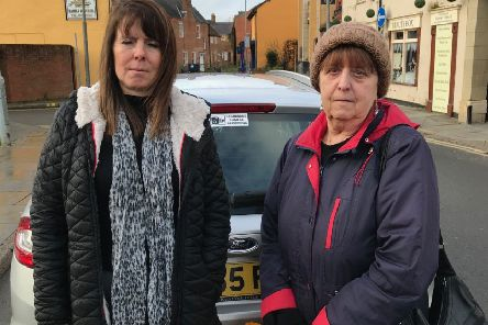 Taxi driver Tracey Cheetham (left), who was given a ticket for dropping off passengers at a Melton bus stop as part of the new bus replacement service, and passenger Stella Goodacre, of Gaddesby EMN-200116-115043001