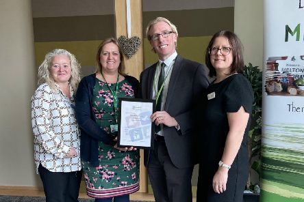 Melton Borough Council chief executive Edd de Coverly receives the Disability Confident Leader status award on behalf of the authority EMN-200124-115934001