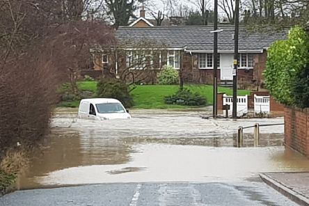 A van almost totally submerged in flood waters at Bottesford after Storm Dennis blew in'PHOTO MATTHEW CANE EMN-200217-095131001
