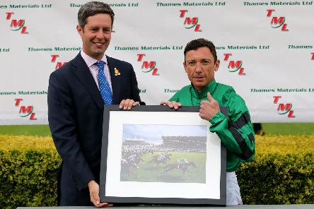 Goodwood clerk of the course Ed Arkell presents Frankie Dettori with a framed picture of one of his wins to mark him reaching 200 course victories / Picture by Sam Stephenson for Goodwood Racecourse