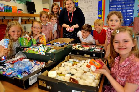 Children from Midhurst C of E Primary School packing donation boxes for the homeless by Donna Ockenden (founder of Four Streets Project). Pic Steve Robards SR1918241