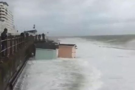A beach hut is swept away as heavy rain and winds hit St Leonards. Picture taken from Dylan Reynolds' video