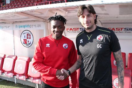 January loan signing from Manchester United Matty Wlllock, pictured with head coach Gabriele Cioffi, makes his first start for Crawley Town.'Picture courtesy of Crawley Town