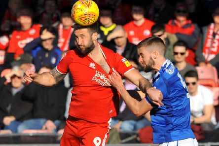 Crawley Town striker Ollie Palmer goes up for a header against Macclesfield Town.'Pic by Steve Robards