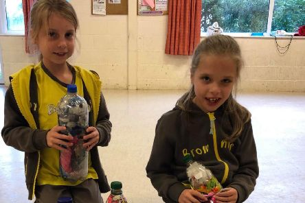 Ava (left) and Zoe (right) pictured with their eco-bricks. Picture: Jacqui Alexander