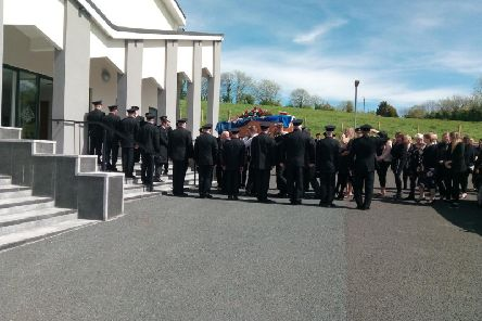 Colleagues at Magherafelt Fire Station formed a guard of honour as Mr Brown's remains were carried into the church.