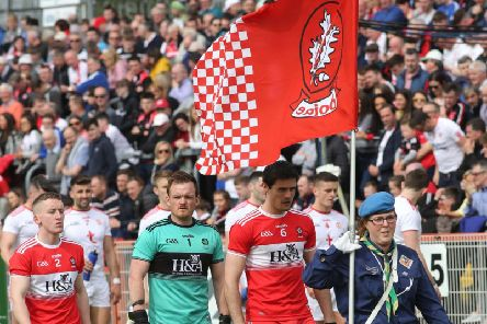 Derry players before Sunday's Ulster Championship game in Healy Park.