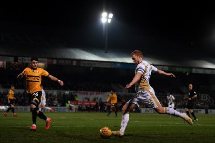 Dean Lewington in action against Newport