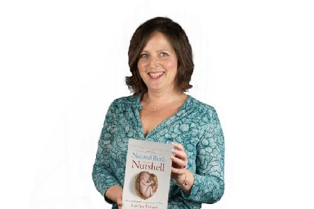 Caroline Richards with her book Natural Birth in a Nutshell