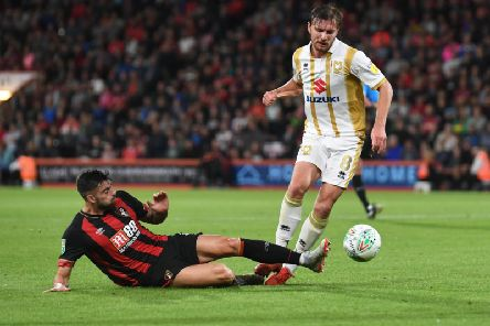 Dons were beaten by Bournemouth in the Carabao Cup second round last season