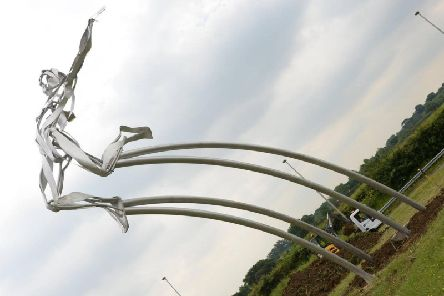Greg Rutherford's statue on the A421 in Milton Keynes