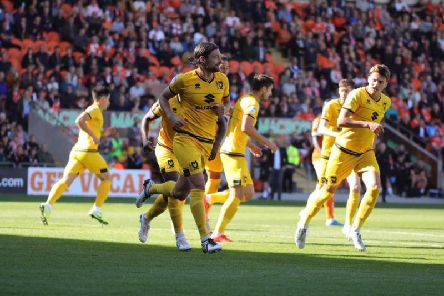 Russell Martin celebrates the opener against Blackpool
