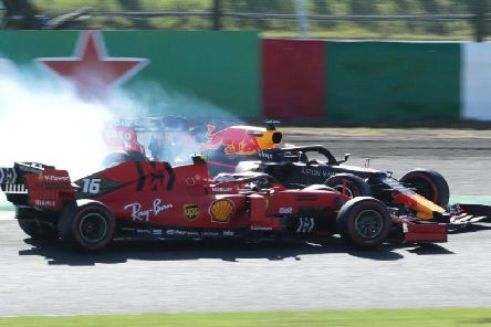 Max Verstappen clashes with Ferrari's Charles Leclerc in Japan