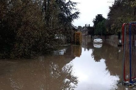 Image showing vehicles stuck in floodwater in the village of Beachampton