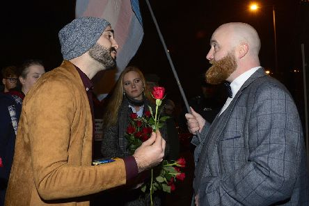 Ex-gay Matthew Grech offers a Valentine's rose to LGBT protestor John O'Doherty before last night's screening.'Photo: Pacemaker: Arthur Allison.