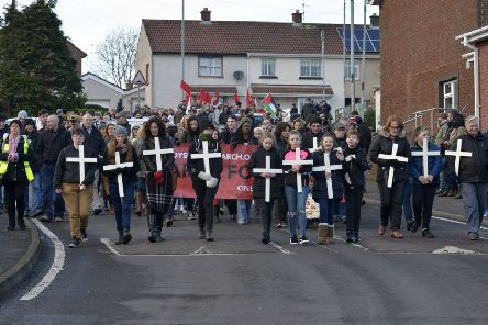 Marchers on the 45th Bloody Sunday anniversary march make their way along Rathlin Drive  in 2017. DER0517GS025