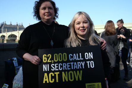 Derry Girls cast members Siobhan McSweeney and Nicola Coughlan (right) join MPs and women impacted by Northern Ireland's strict abortion laws on Westminster Bridge in London. They had a petition of almost 70,000 signatures calling on the Secretary of State to force through reforms.  Photo: Jonathan Brady /PA Wire