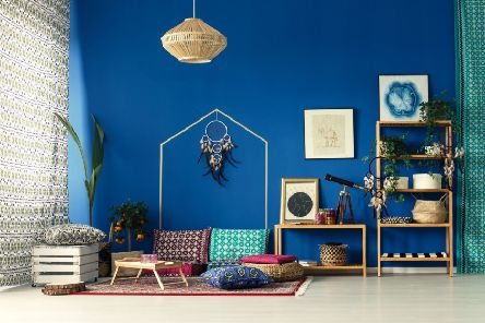 Undated Handout Photo of LEO  Bohemian home interior with cobalt blue wall and bright green plants to suit an outgoing Leo.  See PA Feature INTERIORS Horoscope Decor. Picture credit should read: ScS/PA. WARNING: This picture must only be used to accompany PA Feature INTERIORS Horoscope Decor. WARNING: This picture must only be used with the full product information as stated above.