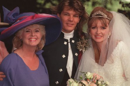 Gloria with Caron and her husband Russ on their wedding day
