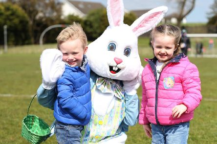The sun was shining but it was chilly at Ballymoney Spring Fair at the weekend, where Daniel and Maeve enjoyed some Easter-themed fun. Pic: Steven McAuley/McAuley Multimedia