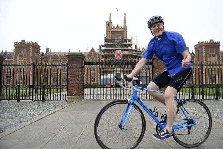 Rev Barry Forde, who is cycling the length of Ireland for charity,  outside Queen's in Belfast