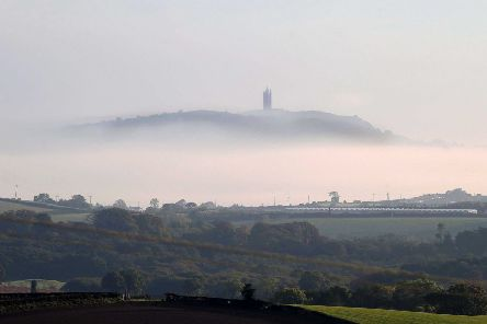 Northern Ireland- 29th September 2014 Picture by Jonathan Porter/Presseye.com. ''Early morning mist surrounds Scrabo Tower as the sun rises over Co. Down.