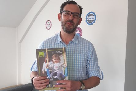 Paul Livingstone, partnership manager, CAP Northern Ireland, with a copy of the charity's Changing Perceptions report.