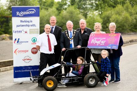The Mayor of Antrim and Newtownabbey, Alderman John Smyth, is joined by Aidan Wilson from Robinsons; Ross McCowan, Ross Joint; Michael Workman, MW Tyres; Alderman Mandy Girvan, Valerie Jenkins and children to launch Ballyclare May Fair.