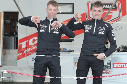 Sidecar stars Ben and Tom Birchall give a thumbs down after opening qualifying at the Isle of Man TT on Saturday was hit by the weather. Picture: Dave Kneen/Pacemaker Press.