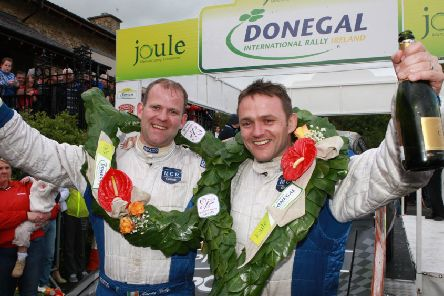 Manus Kelly (left) celebrates success with navigator Donal Barrett at a previous Donegal International Rally