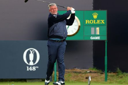 Darren Clarke tees off the 1st to start day one of The Open Championship 2019 at Royal Portrush Golf Club