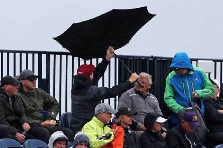 Spectators umbrella turns inside out in the stands during day four of The Open Championship 2019 at Royal Portrush Golf Club.  Niall Carson/PA Wire